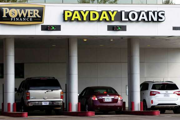 Power Finance and similar stores, Mayor Annise Parker says, can victimize borrowers without adequate regulations.
