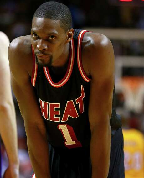 Chris Bosh turned down a lot of money from the Rockets to remain with the Heat. Photo: Mike Ehrmann, Staff / 2014 Getty Images