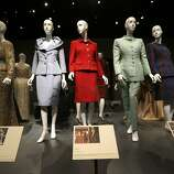 """This July 17, 2014 photo shows Oscar de la Renta outfits on display in Dallas. The ensembles are among more than 60 featured in a new retrospective on de la Renta's career that opens Saturday at the George W. Bush Library and Museum. """"Oscar de la Renta: Five Decades of Style,"""" which runs through Oct. 5, features designs worn by everyone from celebrities to socialites to first ladies. (AP Photo/LM Otero)"""