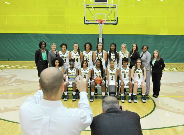 Siena women's basketball team members and coaching staff pose for the official team photograph during media day at the Alumni Recreation Center on Monday, Oct. 20, 2014, in Loudonville, N.Y.   (Paul Buckowski / Times Union) Photo: Paul Buckowski / 00029074A