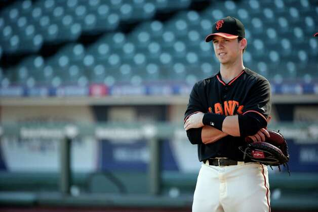 San Francisco Giants catcher Buster Posey waits for practice to begin during a team workout on Saturday, Oct. 18, 2014, in San Francisco. The Giants are scheduled to play the Kansas City Royals in Game 1 of baseball's World Series on Tuesday, Oct. 21, in Kansas City.  (AP Photo/Marcio Jose Sanchez) ORG XMIT: FXPB102 Photo: Marcio Jose Sanchez / AP