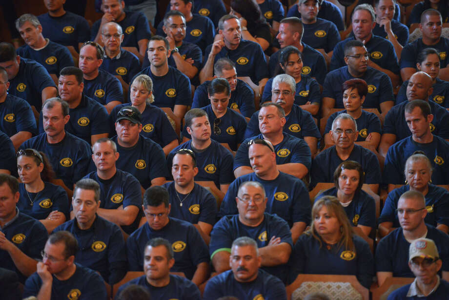 Members of the police and firefighters unions fill the Norma Rodriguez City Council Chamber's during Thursday's council meeting to approve the FY2015 budget. Photo: For The San Antonio Express-News