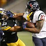 Houston Texans running back Arian Foster (23) pushes off the face mask of Pittsburgh Steelers free safety Mike Mitchell, left, during the second quarter of an NFL football game at Heinz Field on Monday, Oct. 20, 2014, in Pittsburgh.