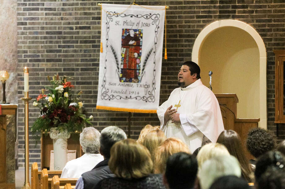 "Father Steven Gamez, celebrating Mass in February at St. Philip of Jesus Catholic Church, where he is the pastor, said Pope Francis' ""who am I to judge"" mentality is spreading in all facets of church life. Photo: San Antonio Express-News File Photo / EN Communities 2014"