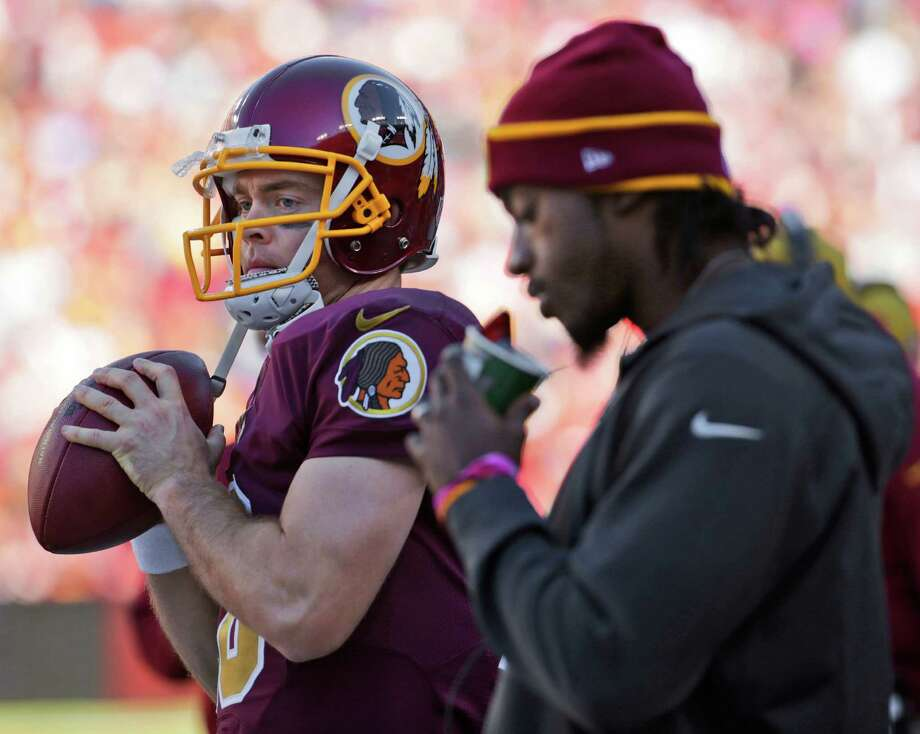 If injured starting QB Robert Griffin III, right, is unable to go against the Cowboys on Monday, former UT star Colt McCoy would start for the Redskins. Photo: Pablo Martinez Monsivais, STF / AP