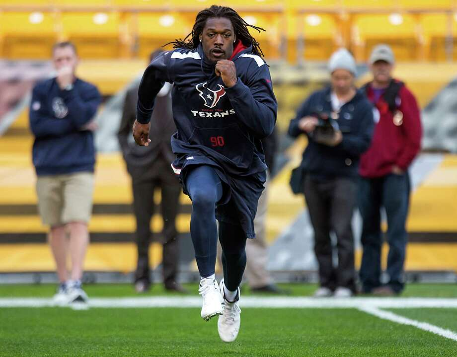 Rookie linebacker Jadeveon Clowney went through a series of six sprints three hours before Monday night's game but was declared inactive. Photo: Brett Coomer, Staff / © 2014  Houston Chronicle