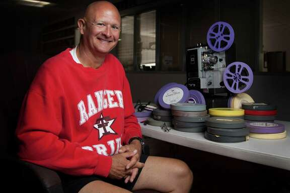 Like an old sidekick, a 16-mm film projector has been a constant companion for Terry coach Tim Teykl, who uses it to extol the virtues of option formations used by teams of a bygone era. Tekyl has about 250 canisters of film.