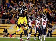PITTSBURGH, PA - OCTOBER 20:  Martavis Bryant #10 of the Pittsburgh Steelers celebrates with Darrius Heyward-Bey #85 after catching a 35 yards touchdown pass in the second quarter against Andre Hal #29 of the Houston Texans during their game at Heinz Field on October 20, 2014 in Pittsburgh, Pennsylvania.  (Photo by Justin K. Aller/Getty Images) ORG XMIT: 507870847
