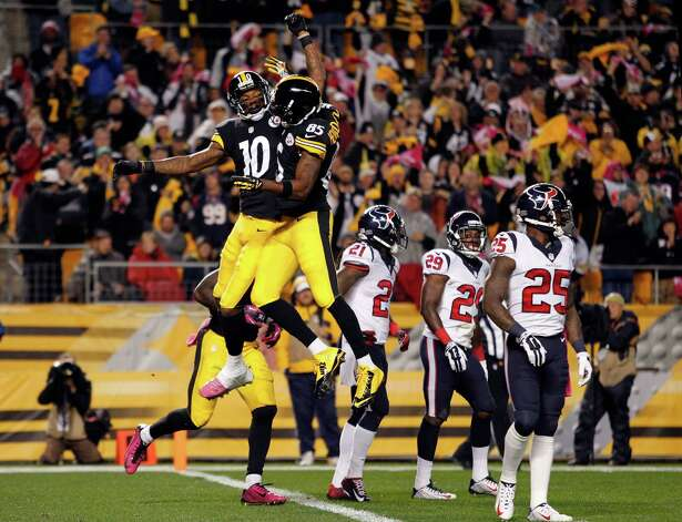 PITTSBURGH, PA - OCTOBER 20:  Martavis Bryant #10 of the Pittsburgh Steelers celebrates with Darrius Heyward-Bey #85 after catching a 35 yards touchdown pass in the second quarter against Andre Hal #29 of the Houston Texans during their game at Heinz Field on October 20, 2014 in Pittsburgh, Pennsylvania.  (Photo by Justin K. Aller/Getty Images) ORG XMIT: 507870847 Photo: Justin K. Aller / 2014 Getty Images