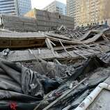 The crumpled remains of the former Houston Club building that was imploded by commercial developer Skanska USA at 811 Rusk St. to make way for the Capitol Tower, a 35-story 750,000 square-foot office space. Monday, Oct. 20, 2014, in Houston, Texas.