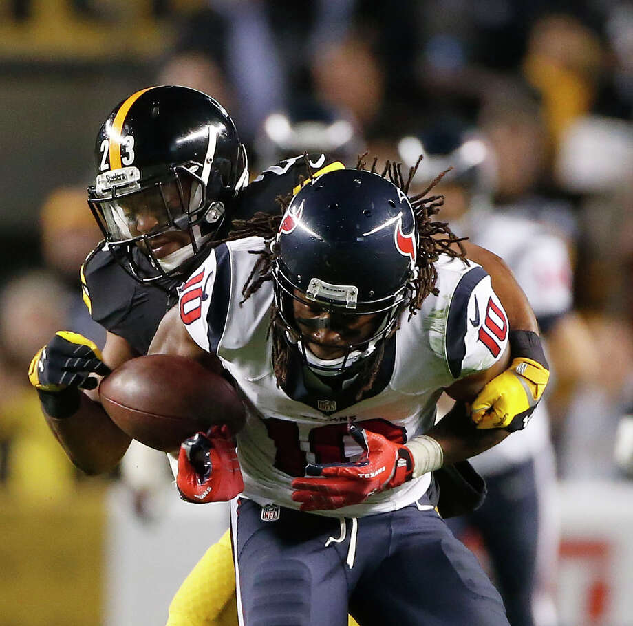 With the Texans trying to mount a comeback in the fourth quarter, wide receiver DeAndre Hopkins turns the ball over as he is stripped by the Steelers' Mike Mitchell. Photo: Karen Warren, Staff / © 2014 Houston Chronicle