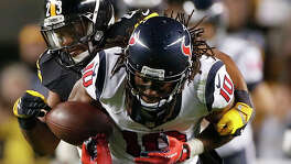 With the Texans trying to mount a comeback in the fourth quarter, wide receiver DeAndre Hopkins turns the ball over as he is stripped by the Steelers' Mike Mitchell.