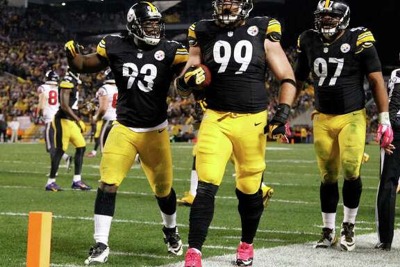 What's wrong with this picture? The No. 99 making a huge play is in the wrong uniform. Steelers defensive end Brett Keisel intercepted a pass late in the second quarter, leading to a Pittsburgh touchdown and capping 24 unanswered points in less than three minutes.