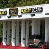 Drive-through lines available for customers at Power Finance Payday Loans building on Monday, Oct. 20, 2014, in Houston
