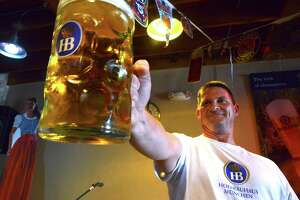 Jason Hurta of New Braunfels is the national champion of  Masskrugstemmen, a German sport in which contestants hold with extended arm a 1-liter stein filled with beer for as long as possible. Sept. 26, 2014.