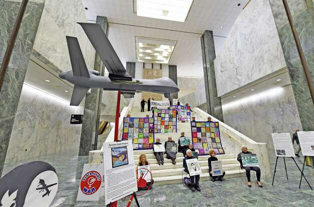 Local peace activists, Woman Against War set up a model of a drone in the well of the Legislative Office Building Monday morning, Oct. 20, 2014, in Albany, N.Y. The display was part of an extensive community awareness initiative concerning the cost of using weaponized drones. (Skip Dickstein/Times Union) Photo: SKIP DICKSTEIN / 00029091A