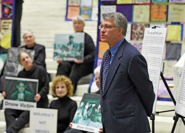 Assemblyman Phil Steck speaks at a demonstration organized by local peace activist group, Woman Against War Monday morning, Oct. 20, 2014, in the well of the Legislative Office Building in Albany, N.Y.  The demonstration was part of an extensive community awareness initiative concerning the cost of using weaponized drones. (Skip Dickstein/Times Union) Photo: SKIP DICKSTEIN / 00029091A