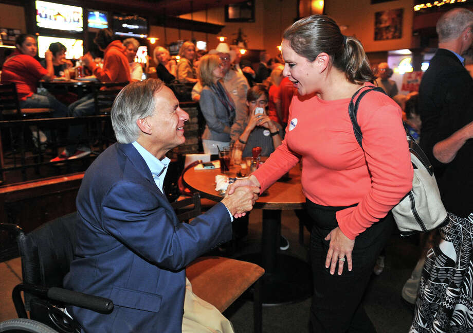 Kristi Butler shakes hands with Gubernatorial candidate Greg Abbott during a stumping session at Maddison's in Beaumont on Monday.    Photo taken Monday, October 20, 2014  Guiseppe Barranco/@spotnewsshooter Photo: Guiseppe Barranco, Photo Editor