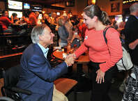 Kristi Butler shakes hands with Gubernatorial candidate Greg Abbott during a stumping session at Maddison's in Beaumont on Monday.    Photo taken Monday, October 20, 2014  Guiseppe Barranco/@spotnewsshooter