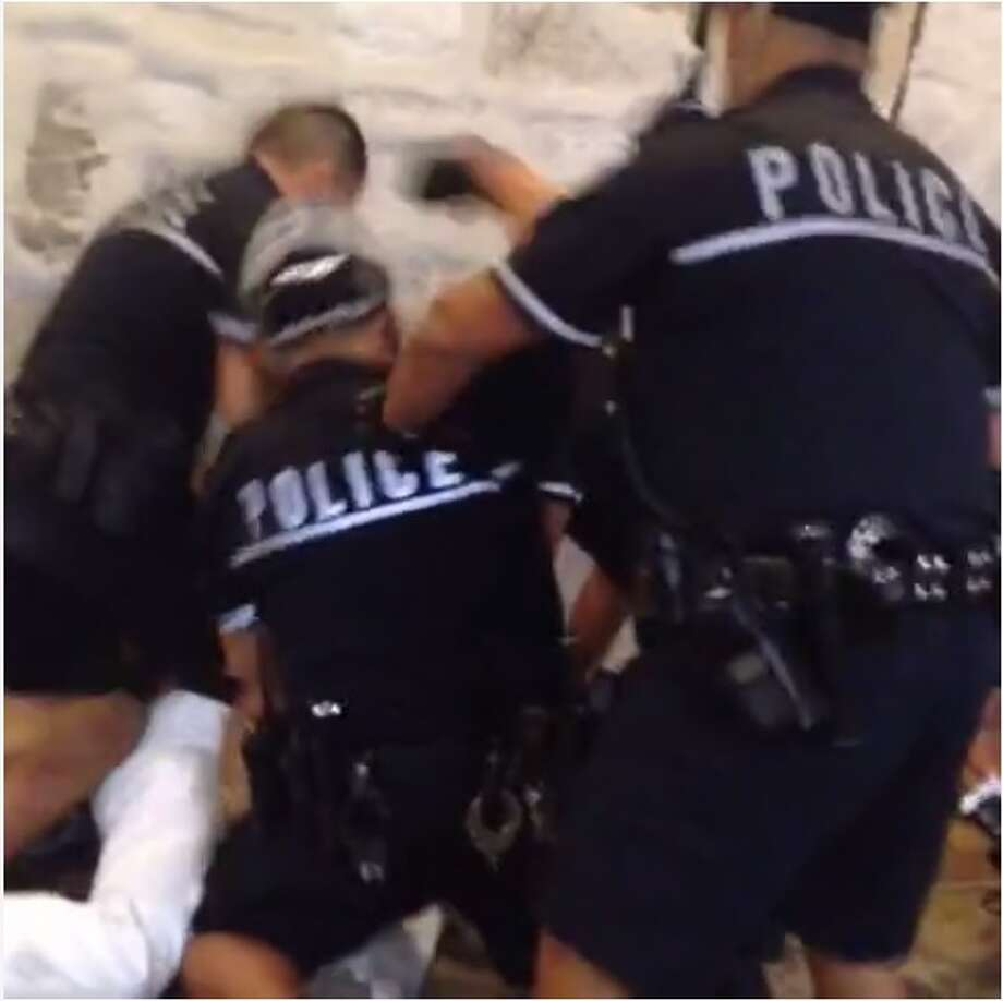 Cameras were rolling Sunday morning when San Antonio Police Department officers engaged in a violent struggle downtown. Photo: Vine/Screenshot