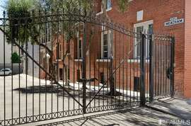 The gate in front of Meacham Place