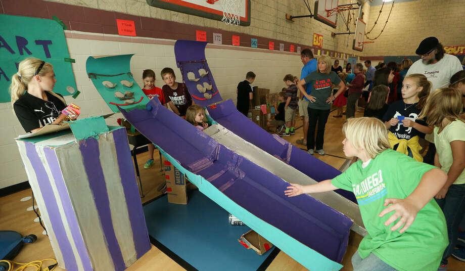 "Fourth grader Cade Kinstley (lower right), 10, tries his hand at ""Smart Ball,"" made by Mrs. Vieger's fifth grade class, during Huebner Elementary's ""First Day of Play"" event for the Global Cardboard Challenge. Photo: Photos By Marvin Pfeiffer / Stone Oak Weekly / Express-News 2014"