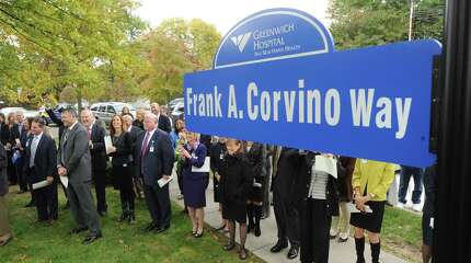 """The retirement ceremony for Greenwich Hospital President and CEO, Frank Corvino, at the hospital in Greenwich, Conn., Tuesday, Oct. 21, 2014. Corvino was honored with a street sign in front of the hospital reading, """"Frank A. Corvino Way."""""""