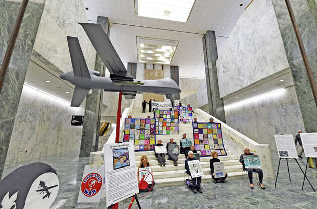 The Woman Against War set up a model of a drone in the well of the Legislative Office Building Monday morning Oct. 20, 2014 in Albany, N.Y.  as part of an extensive community awareness initiative concerning the cost of using weaponized drones. (Skip Dickstein/Times Union) Photo: SKIP DICKSTEIN, ALBANY TIMES UNION / 00029091A