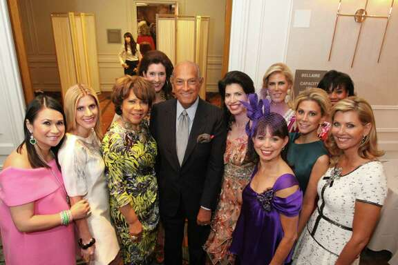 BACKSTAGE MOMENT: Oscar de la Renta, center, with 2010's Best Dressed honorees, including, from left: Katherine Le, Greggory Burk, Merele Yarborough, Phoebe Tudor, Kelli Cohen Fein, Danielle Ellis (in foreground), Courtney Hopson, Courtney Hill Fertitta, Eileen Lawal and Susan Plank. The Houston  Chronicle's 2010 Best Dressed Luncheon and Neiman Marcus Fashion Presentation benefiting the March of Dimes. Bill Olive Photography 2010.