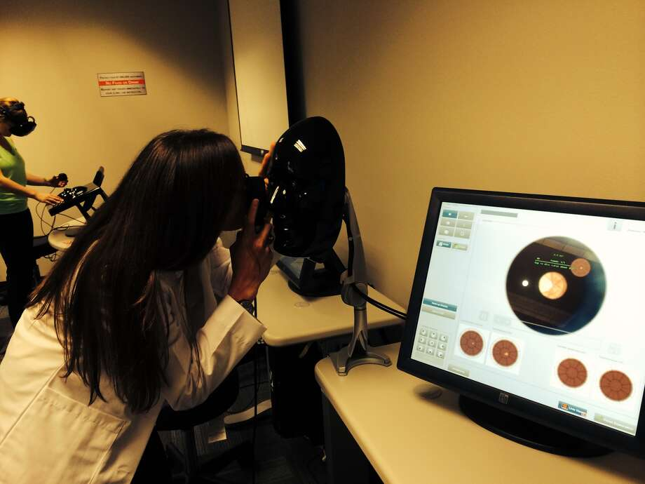 "Amanda Wheeler, a second-year student at the University of Houston's College of Optometry, examines the retina of a virtual ""patient"" in the school's new Simulation Lab. (Kyrie O'Connor 