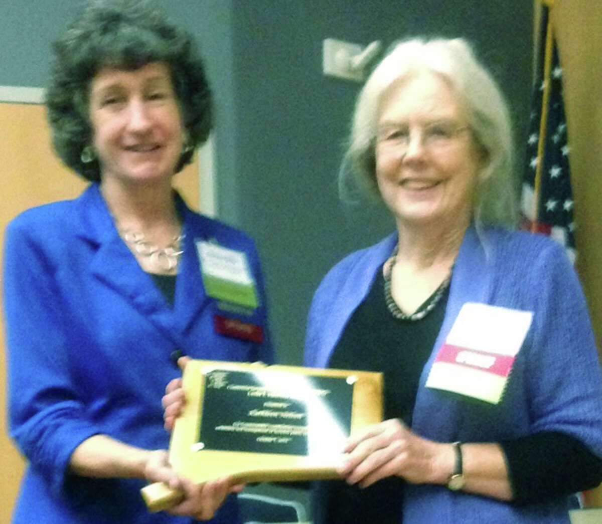 Kathleen Nelson, right, of New Milford receives the Les Mehrhoff Award from Donna Ellis during the Connecticut Invasive Working GroupâÄôs annual meeting recently at the University of Connecticut in Storrs. October 2014 Courtesy of Bob Gambino