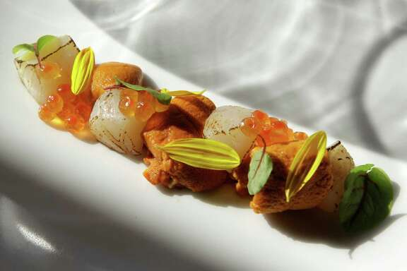 Among the sensational dishes Kuu serves is Utate, cured scallop with uni and smoked sea salt.