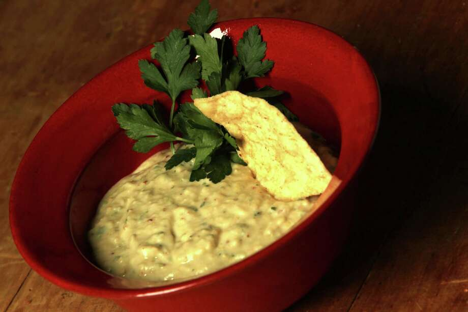 White Bean Dip ups the sophistication level on this appetizer. Photo: Billy Smith II, Staff / © 2014 Houston Chronicle