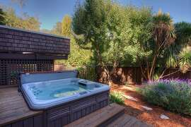 The Mill Valley home includes a hot tub and drought-tolerant plantings.