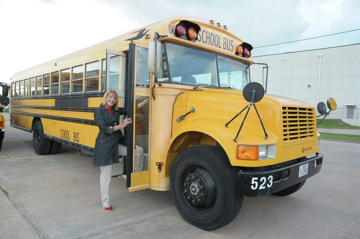 Lynda Zelenka, executive director of Cypress Hope, with bus 523, which the organization is purchasing to become a mobile science, technology, engineering and math lab.