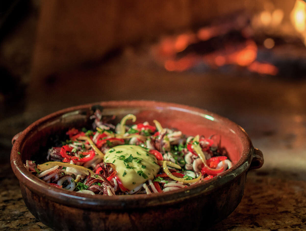 The squid ink bomba, cooked in the wood-fired oven at Shakewell, blends ingredients to enliven the black rice.