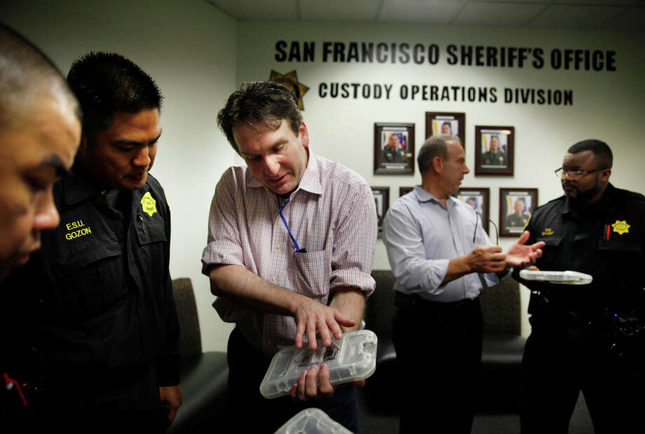 Chris Grewe, American Prison Data Systems founder and CEO, shows S.F. Jail personnel how the tablets work. Photo: Lea Suzuki / The Chronicle / ONLINE_YES