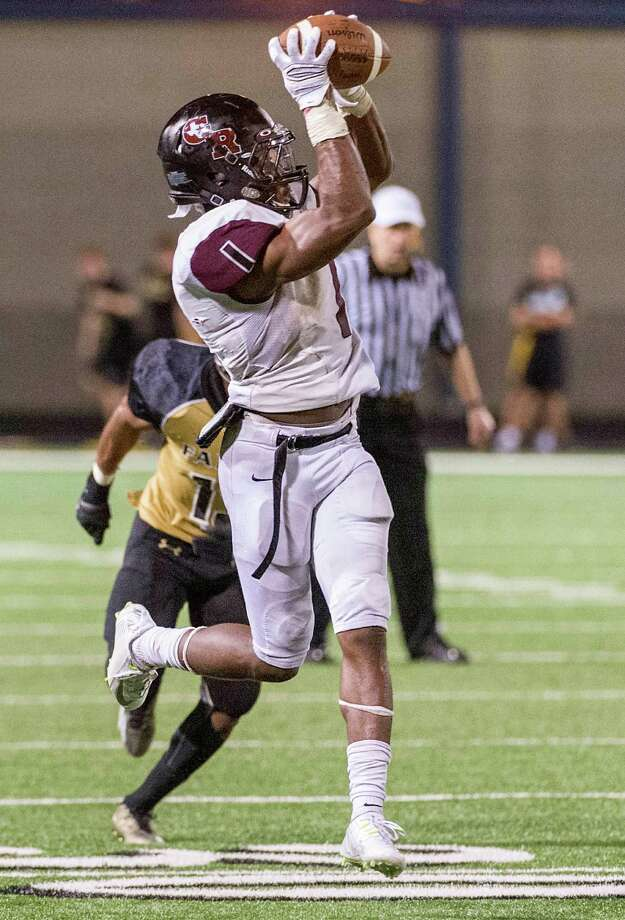 George Ranch running back Darius Anderson (1) hauls in a touchdown pass during the second half of a high school football game against Foster at Traylor Stadium, Friday, Oct. 10, 2014, in Rosenberg. ( Smiley N. Pool / Houston Chronicle ) Photo: Smiley N. Pool, Staff / © 2014  Houston Chronicle