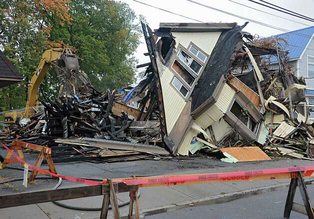 A house at 2033 Broadway is the first of about 89 run-down homes to be demolished on Tuesday, Oct. 21, 2014 in Schenectady, N.Y. Sen. Charles Schumer joined Schenectady city officials for the demolition and helped the city get about $3 million to help with the cost of knocking down these structures. (Lori Van Buren / Times Union) Photo: Lori Van Buren / 00029128A