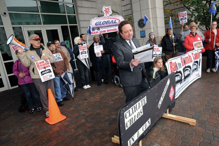 Roger Downs with the Atlantic Chapter Sierra Club joins protesters to denounce the state DEC, for what they claim is a failure to protect the health, safety, and welfare of New Yorkers knowing that the transport of crude oil-by-rail is unsafe, Tuesday Oct. 21, 2014, in front of the DEC offices in Albany, N.Y.  Protesters include members of Earthjustice and People of Albany United for Safe Energy (PAUSE).  (Michael P. Farrell/Times Union) Photo: Michael P. Farrell / 00029086A