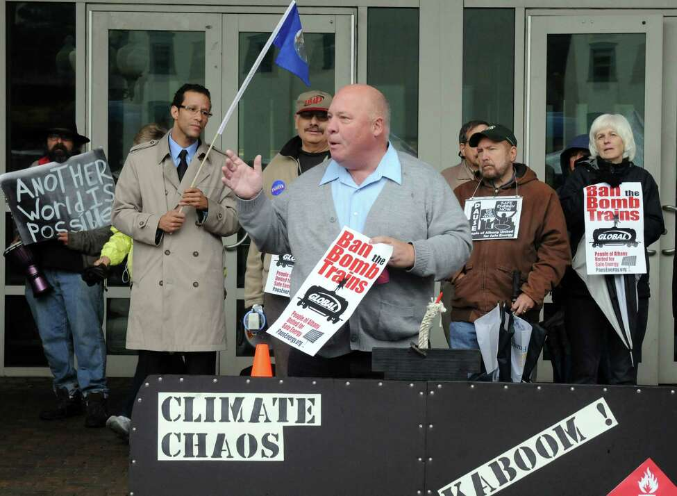 Mark Emanatian of Watervliet joins protesters to denounce the state DEC, for what they claim is a failure to protect the health, safety, and welfare of New Yorkers knowing that the transport of crude oil-by-rail is unsafe, Tuesday Oct. 21, 2014, in front of the DEC offices in Albany, N.Y. Protesters include members of Earthjustice and People of Albany United for Safe Energy (PAUSE). (Michael P. Farrell/Times Union)