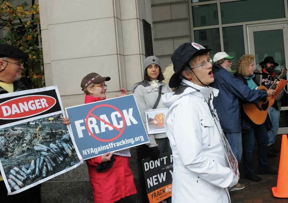 Sandy Steubing, front right, joins protesters to denounce the state DEC, for what they claim is a failure to protect the health, safety, and welfare of New Yorkers knowing that the transport of crude oil-by-rail is unsafe, Tuesday Oct. 21, 2014, in front of the DEC offices in Albany, N.Y. Protesters include members of Earthjustice and People of Albany United for Safe Energy (PAUSE). (Michael P. Farrell/Times Union)