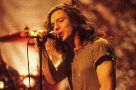 "1992: Vedder, pictured shortly before he started drawing on himself during ""Pearl Jam: MTV Unplugged."""