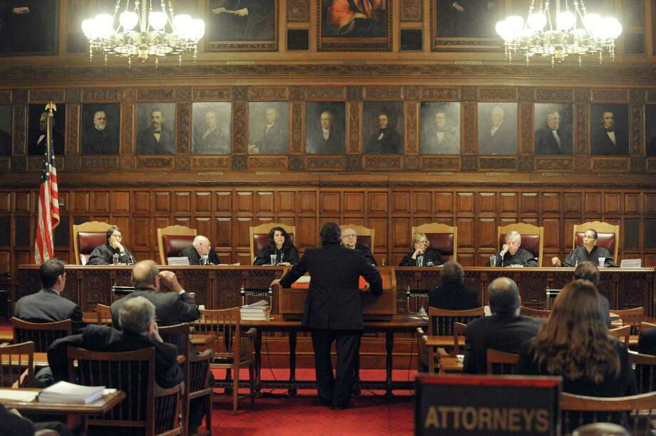 The New York State Court of Appeals listens to court arguments on behalf of an organization of pagans who claim they should keep their property tax exemption as a religious group Tuesday, Oct. 21, 2014, at the Court of Appeals in Albany, N.Y.  (Michael P. Farrell/Times Union) Photo: Michael P. Farrell / 00029126A