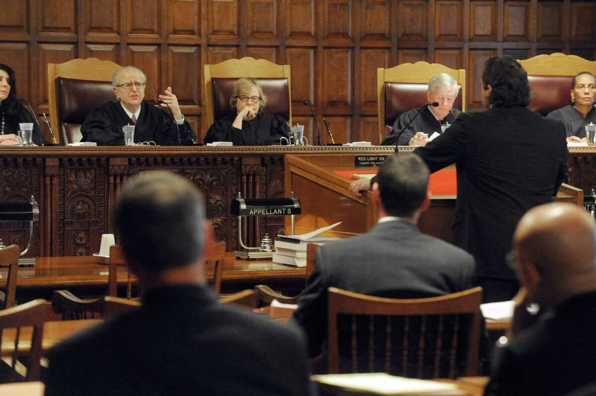 The New York State Court of Appeals listens to court arguments on behalf of an organization of pagans who claim they should keep their property tax exemption as a religious group Tuesday, Oct. 21, 2014, at the Court of Appeals in Albany, N.Y. (Michael P. Farrell/Times Union)