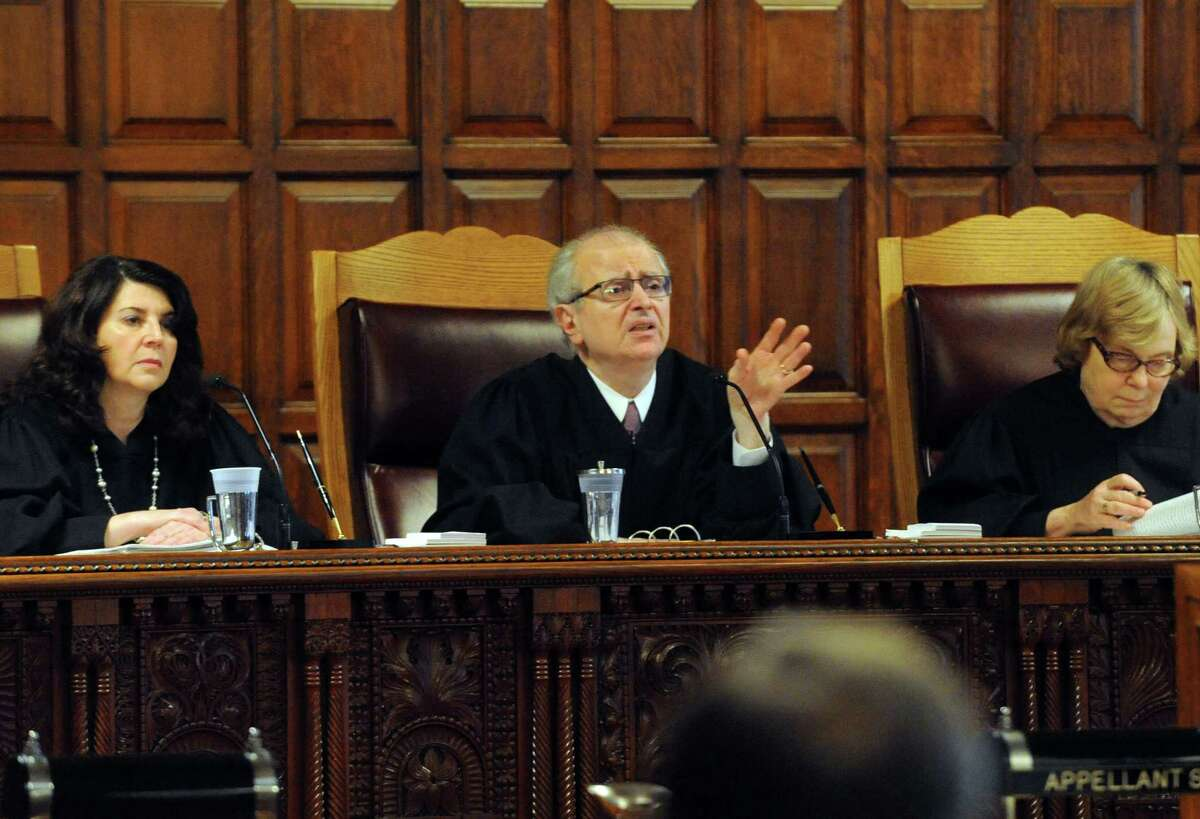Chief Judge Jonathan Lippman,center, asks a question as the New York State Court of Appeals listens to court arguments on behalf of an organization of pagans who claim they should keep their property tax exemption as a religious group Tuesday, Oct. 21, 2014, at the Court of Appeals in Albany, N.Y. (Michael P. Farrell/Times Union)