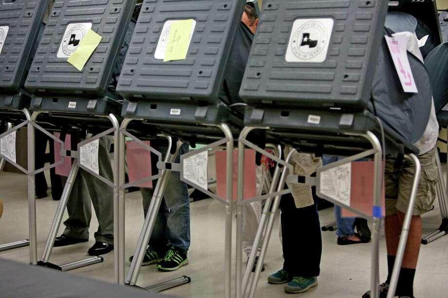Voters mark their ballots during early voting at State Representative District 134M at Houston's Metropolitan Multi Service Center on Monday, Oct. 20. Photo: Gary Coronado, MBI / Houston Chronicle