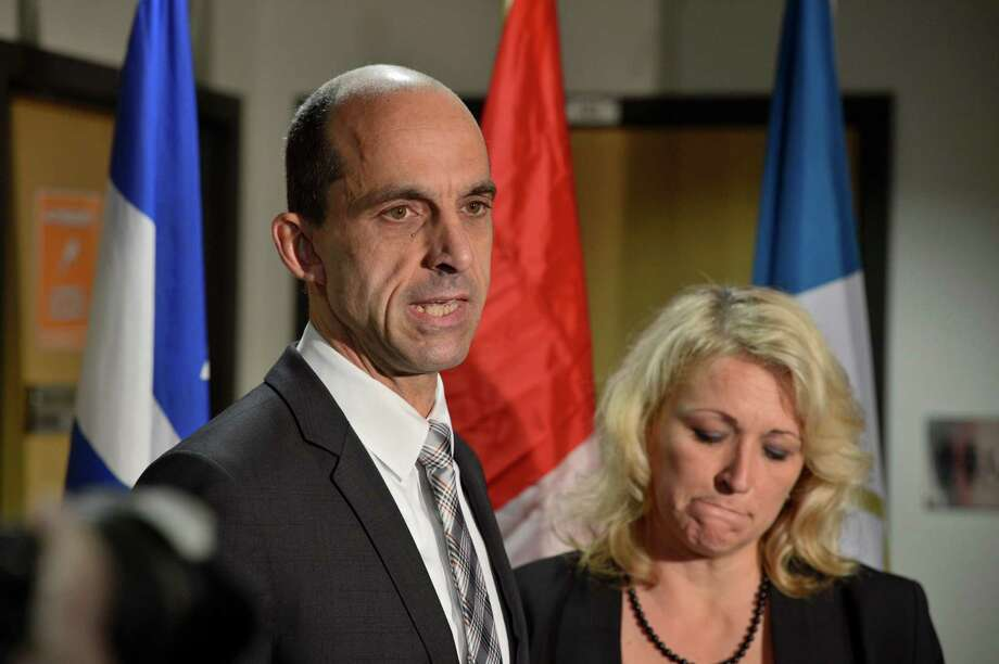 Public Safety Minister Steven Blaney and Transport Minister Lisa Raitt address reporters at a news conference in St-Jean-sur-Richelieu, Quebec, on Tuesday Oct. 21, 2014. One of two soldiers hit by a car on Monday in Saint-Jean-sur-Richelieu, Quebec, died of his injuries early Tuesday, according to Quebec provincial police. An official familiar with the case said the suspect, Martin Couture Rouleau, 25, of Saint-Jean-sur-Richelieu, was influenced by radical Islamists. (AP Photo/The Canadian Press, Paul Chiasson) Photo: Paul Chiasson, SUB / The Canadian Press