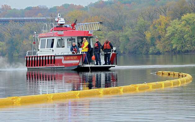 The New York State Department of Environmental Conservation (DEC) conducts a joint oil spill training exercise with Canadian Pacific (CP) railroad, and the Albany Fire Department on the Hudson River at the Port of Albany in Albany, N.Y.  (Lori Van Buren / Times Union) Photo: Lori Van Buren / 00029141A