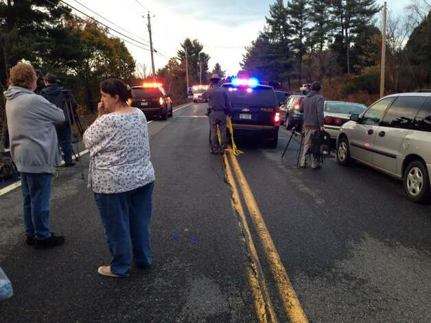 Route 7 in Pittstown is blocked after a crash that involved a school bus and a car on Tuesday, Oct. 21. The driver of the car, a 55-year-old Green Island man, was killed. (Paul Buckowski / Times Union)